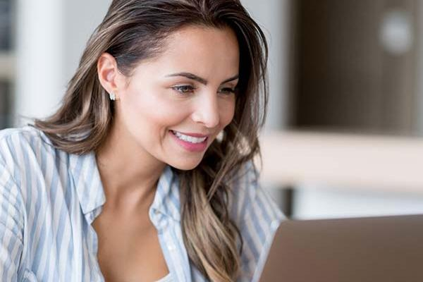 Photo of woman looking at laptop screen