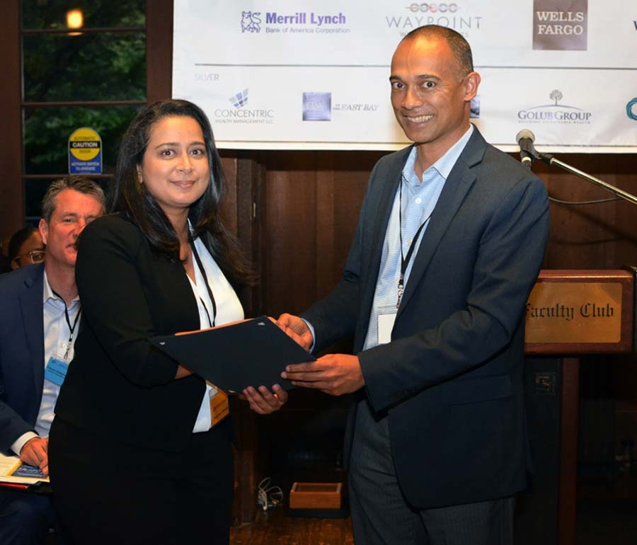 Program Director Ashish Mukharji presented the Golub Group Outstanding Student Award to Preetika Pande.