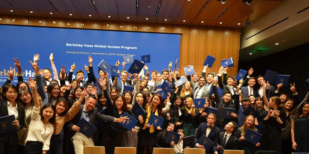 BHGAP international students throw their arms up in celebration during their closing ceremony photo.