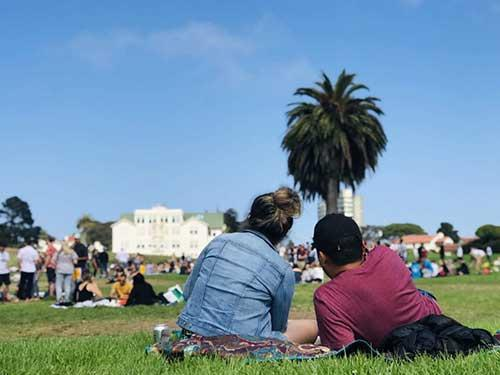 Picture of students sitting on grass in a San Francisco park