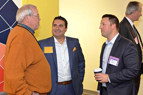 From left: Advisory board member Gordon Dunne, speaker Christopher Mercado and an event attendee