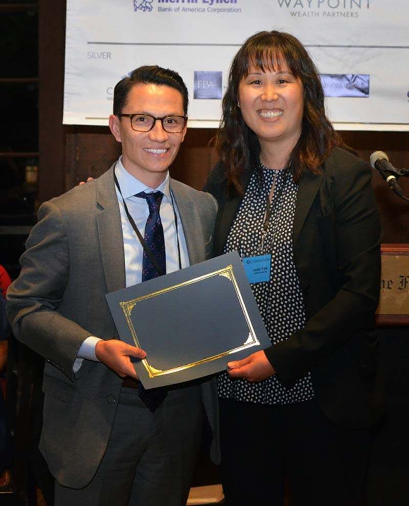 PFP certificate student Juan Gachet is awarded a scholarship from the Personal Financial Planning Program Advisory Board.