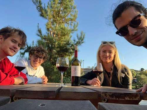 Frederic Bock and friends drinking wine