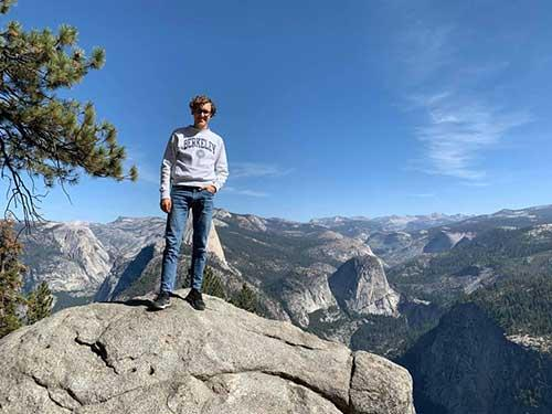 Frederic Bock stands on a rock in Yosemite